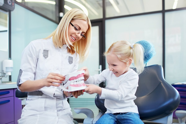 How Soon Should A Child See A Kid Friendly Dentist In Atlantis After Knocking Out A Permanent Tooth?
