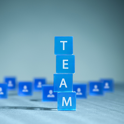 "square blue blocks spelling out the word ""Team"""